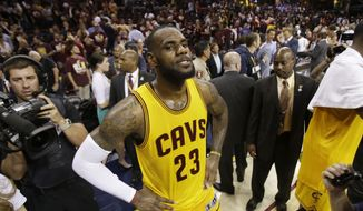 Cleveland Cavaliers forward LeBron James (23) waits to be interviewed at the conclusion of Game 3 of basketball's NBA Finals against the Golden State Warriors in Cleveland, Tuesday, June 9, 2015. The Cavaliers defeated the Warriors 96-91. AP Photo/Tony Dejak)