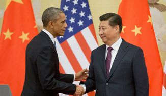 U.S. President Barack Obama, left, and Chinese President Xi Jinping shake hands following the conclusion of their joint news conference at the Great Hall of the People in Beijing, Wednesday, Nov. 12, 2014. (AP Photo/Pablo Martinez Monsivais) ** FILE **