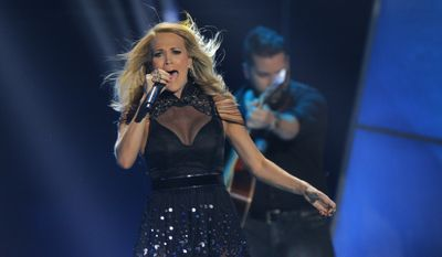 Carrie Underwood performs at the CMT Music Awards at Bridgestone Arena on Wednesday, June 10, 2015, in Nashville, Tenn. (Photo by Wade Payne/Invision/AP)