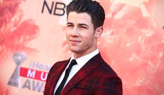 FILE - In this March 29, 2015 file photo, Nick Jonas arrives at the iHeartRadio Music Awards at The Shrine Auditorium, in Los Angeles. Jonas is replacing Iggy Azalea as the headline performer at a Pittsburgh gay pride event. Azalea withdrew from the Saturday, June 13, 2015, Pride in the Street concert amid criticism for making anti-gay and racist remarks on social media. (Photo by John Salangsang/Invision/AP, File)
