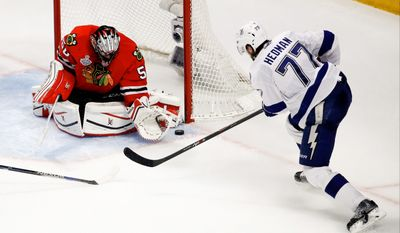 Chicago received a strong Game 4 from goalie Corey Crawford, including a stop on a shot by Tampa Bay's Victor Hedmanin the third period. Crawford has won 11 playoff games since a benching in the first round. (Associated Press)
