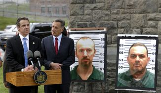 New York Gov. Andrew Cuomo, left, speaks while Vermont Gov. Peter Shumlin listens during a news conference in front of the Clinton Correctional Facility in Dannemora, N.Y., Wednesday, June 10, 2015.  Police were resuming house-to-house searches near the maximum-security prison in northern New York where David Sweat and Richard Matt, two killers escaped using power tools, authorities said Wednesday as they renewed their plea for help from the public. (AP Photo/Seth Wenig)