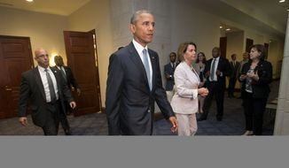 President Barack Obama and House Minority Leader Nancy Pelosi of Calif. leave meeting with House Democrats on Capitol Hill in Washington, Friday, June 12, 2015. The president made an 11th-hour appeal to dubious Democrats on Friday in a tense run-up to a House showdown on legislation to strengthen his hand in global trade talks (AP Photo/Pablo Martinez Monsivais) **FILE**