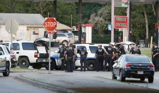 Police block the intersection of Dowdy Ferry Rd and Interstate 45 during a stand off with a gunman barricaded inside a van, Saturday, June 13, 2015, in Hutchins, Texas. The gunman allegedly attacked Dallas Police Headquarters. (AP Photo/Brandon Wade)