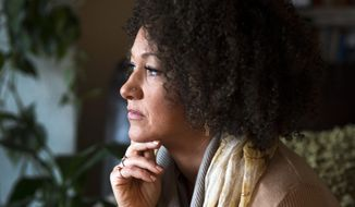 "Spokane NAACP leader Rachel Dolezal sent out an email Sunday canceling the monthly membership meeting ""due to the need to continue discussion with regional and national NAACP leaders."" (Associated Press)"