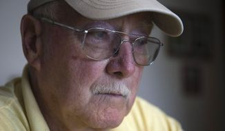 Retired Air Force reserve tech Sgt. Ed Kienle, 73, pauses during an interview at his home, Thursday, June 11, 2015, in Wilmington, Ohio. The government says U.S. Air Force reservists who became ill after being exposed to Agent Orange residue while working on planes after the Vietnam War would be eligible for disability benefits. (AP Photo/John Minchillo)