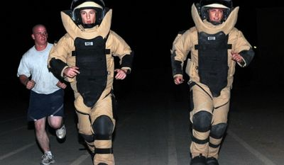 U.S. airmen run in bomb suits on Sept. 12, 2009, while deployed to Kirkuk, Iraq. (Image: U.S. Air Force) ** FILE **