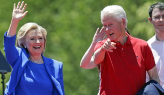 Democratic presidential candidate, former Secretary of State Hillary Rodham Clinton, and former President Bill Clinton, right gesture to supporters Saturday, June 13, 2015, on Roosevelt Island in New York.  (AP Photo/Frank Franklin II)