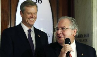FILE - In this Nov. 10, 2014 file photo, Massachusetts Governor-elect Charlie Baker, left, smiles at the Statehouse in Boston, as House Speaker Robert DeLeo speaks to reporters after they met privately.  (AP Photo/Elise Amendola)