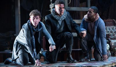 """Guildenstern (Adam Wesley Brown) and Rosencrantz (Romell Witherspoon) try to assist their childhood friend Hamlet (Biko Eisen-Martin) in """"Rosencrantz and Guildenstern Are Dead."""" (Photo by Teresa Wood)"""