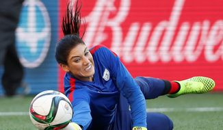 Lauding the success goalkeeper Hope Solo has during the Women's World Cup while not fueling the attention of her behavior off of it poses a difficult dllemma for U.S. Soccer as it seeks a third title. (The Canadian Press Via Associated Press)