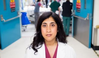 In this June 4, 2015, photo, Dr. Reena Duseja, lead author of a study on emergency room visits, stands in San Francisco General Hospital's emergency room in San Francisco. No one wants to make a repeat visit to the emergency room for the same complaint. But new research suggests it's more common than previously thought, and people frequently wind up at a different ER the second time around. (AP Photo/Noah Berger)