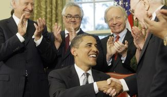 President Barack Obama is congratulated by Franklin E. Kameny, right, after delivering brief remarks and signing a Presidential Memorandum regarding federal benefits and non-discrimination during a ceremony in the White House Oval Office, Wednesday, June 17, 2009, in Washington. Applauding from left to right is Vice President Joe Biden, Rep. Barney Frank, D-Mass., and Sen. Joseph Lieberman, I-Conn. (AP Photo/Haraz N. Ghanbari)