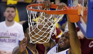 Golden State Warriors forward Andre Iguodala (9) dunks against the Cleveland Cavaliers during the second half of Game 5 of basketball's NBA Finals in Oakland, Calif., Sunday, June 14, 2015. (AP Photo/Eric Risberg)