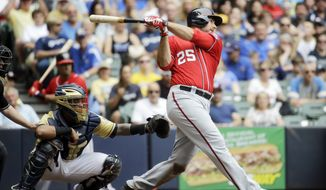 Washington Nationals' Clint Robinson hits a two-run scoring double during the seventh inning of a baseball game against the Milwaukee Brewers, Sunday, June 14, 2015, in Milwaukee. (AP Photo/Morry Gash)