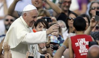 Pope Francis blesses the faithful as he arrives on the occasion of an audience with participants of Rome's diocese convention in St. Peter's Square, at the Vatican, Sunday, June 14, 2015. (AP Photo/Gregorio Borgia)