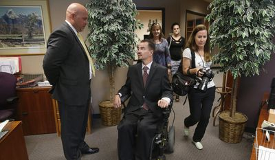"""The Colorado Supreme Court ruled Monday 6-0 that Brandon Coats (right), a medical marijuana patient that was fired by Dish Network, cannot get his job back. Mr. Coats' attorney Michael Evans (left) said the case garnered national attention because it was a """"perfect storm."""" (Associated Press)"""