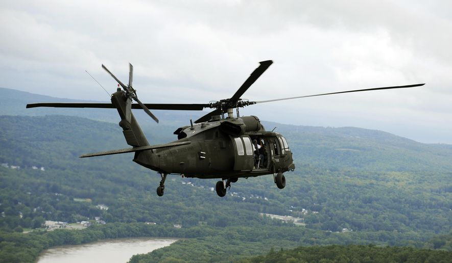 A New York National Guard Sikorsky Blackhawk UH-60 helicopter carries New York Gov. Andrew Cuomo and other state lawmakers on a tour of flood damaged areas in Binghamton and the Southern Tier, flying from the Greater Binghamton Airport in Johnson City  N.Y., in this Sept. 9, 2011, file photo. (AP Photo/Hans Pennink, File )