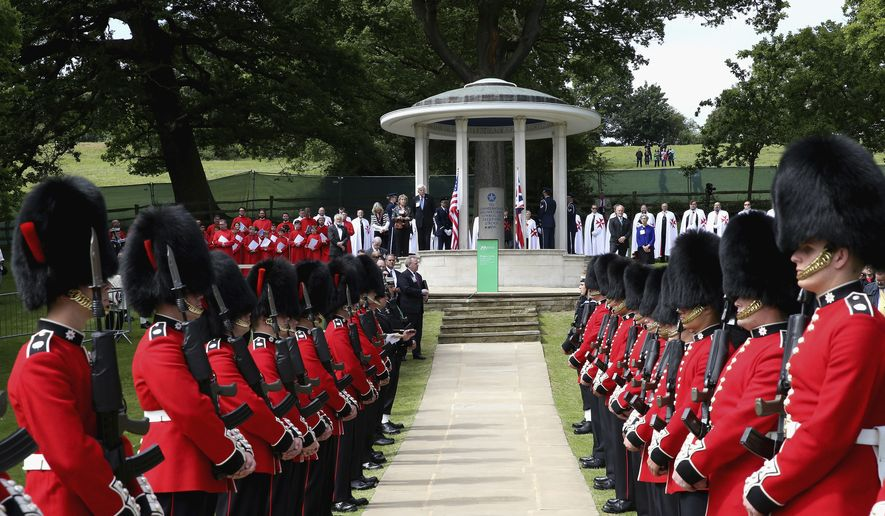 """Soldiers provide an honor guard before the Magna Carta Memorial with its simple inscription """"To commemorate Magna Carta, symbol of freedom under law"""" at Runnymede, England, during a commemoration ceremony, Monday June 15, 2015, to celebrate the 800th anniversary of the groundbreaking accord called Magna Carta. In 1215, Britain's King John met disgruntled barons at Runnymede and agreed to a list of basic rights and laws called Magna Carta, which have formed the basic tenets of modern civil liberties, and was an inspiration for the U.S. Constitution among many other worldwide influences. (Chris Jackson/Pool photo via AP) ** FILE **"""
