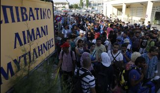 Syrian migrants who have been stranded for days, in the northeastern Greek island of Lesvos, stand in queue as they wait for travel documents from Greek authorities at the port of Mytilene on Monday, June 15, 2015. An emergency European Union plan to help Italy and Greece manage thousands of migrants crossing the Mediterranean could be vastly watered down on Tuesday, according EU diplomats. During the first five months of 2015, 40,297 migrants arrived in Greece, up from 6,500 in the same period in 2014. Almost all of them have crossed in boats from Turkey. The sign reads ''Passenger Terminal of Mytilene.'' (AP Photo/Thanassis Stavrakis)
