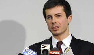 "FILE - In this March 18, 2013 file photo, South Bend Mayor Peter Buttigieg speaks to reporters about a plane crash in South Bend, Ind. Buttigieg has come out as gay in a newly published essay. The first-term Democratic mayor writes in an essay published Tuesday, June 16, 2015,  in the South Bend Tribune that he was well into adulthood ""before I was prepared to acknowledge the simple fact that I am gay."" (AP Photo/Joe Raymond, FILE)"