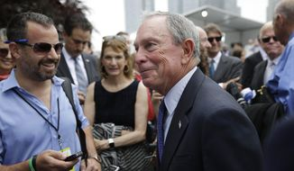 Former New York City Mayor Michael Bloomberg talks to reporters during a ground breaking ceremony for Cornell Tech on Roosevelt Island in New York on June 16, 2015. Bloomberg's charity foundation, Bloomberg Philanthropies, is donating $100 million to Cornell University for the new high-tech graduate school campus. (Associated Press) **FILE**