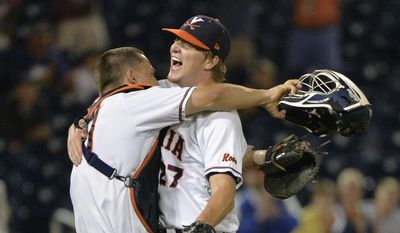 Virginia pitcher Josh Sborz (27) celebrates with catcher Matt Thaiss, left, after a 1-0 win over Florida in an NCAA College World Series baseball game at TD Ameritrade Park in Omaha, Neb., Tuesday, June 16, 2015. (AP Photo/Ted Kirk)