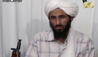 FILE - This image from video released Jan. 23, 2009, by al-Malahim Media Foundation and provided by IntelCenter on Dec. 30, 2009, shows the leader of Al-Qaida in the Arabian Peninsula, identified by the IntelCenter as Nasir al-Wahishi, in Yemen. Al-Qaida on Tuesday, June 16, 2015 confirmed that al-Wahishi, its No. 2 figure and leader of its powerful Yemeni affiliate, was killed in a U.S. strike, making it the harshest blow to the global militant network since the killing of Osama bin Laden.  (IntelCenter via AP, File)