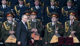Russian President Vladimir Putin, foreground, leaves a podium after delivering his speech at the opening of the Army-2015 international military show features the latest Russian weapons in Kubinka, outside Moscow, Russia, Tuesday, June 16, 2015. (AP Photo/Ivan Sekretarev) ** FILE **