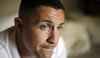 Marine Sgt. Lawrence Hutchins III speaks at his home in Oceanside, Calif., in this Aug. 2, 2013, file photo. (AP Photo/Chris Carlson, File)