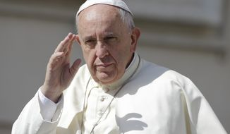 Pope Francis waves as he arrives for his weekly general audience, in St. Peter's Square at the Vatican,  Wednesday, June 17, 2015. (AP Photo/Andrew Medichini)