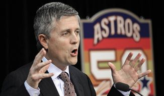 FILE - In this Dec. 8, 2011, file photo, Houston Astros general manager Jeff Luhnow answers a question during a baseball news conference in Houston. The Cardinals have become a model of success by mixing traditional scouting with a heavy dose of analytics, an approach that grew as Jeff Luhnow rose to power in the front office a decade ago. Luhnow took that skill to the Astros, whose player database was allegedly hacked by his former colleagues in St. Louis.  (AP Photo/David J. Phillip, File)