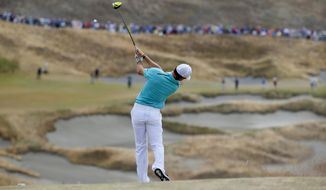 Rory McIlroy, of Northern Ireland, watches his tee shot on the fourth hole during the first round of the U.S. Open golf tournament at Chambers Bay on Thursday, June 18, 2015 in University Place, Wash. (AP Photo/Matt York)