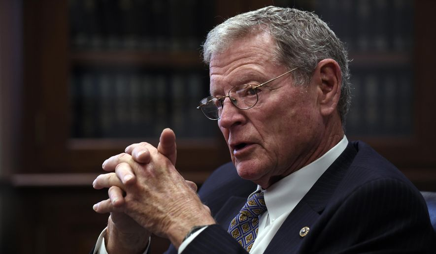 Senate Environment Committee Chairman Sen. James Inhofe, R-Okla., speaks to reporters on Capitol Hill in Washington, in this Jan. 7, 2015 file photo (AP Photo/Susan Walsh)