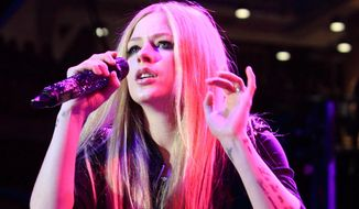 In this Dec. 13, 2013, file photo, Avril Lavigne performs in concert during the Mix 106.5 Mistletoe Meltdown at SECU Arena Towson University in Towson, Md. (Photo by Owen Sweeney/Invision/AP, File)