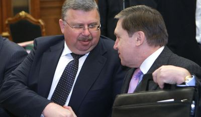 Head of the Federal Customs Service Andrei Belyaninov, left, and Vladimir Putin's aide, Yury Ushakov, seen during a Putin-chaired meeting of officials in Moscow, Tuesday, Feb. 2, 2010. (AP Photo/RIA-Novosti, Alexei Nikolsky, Pool)