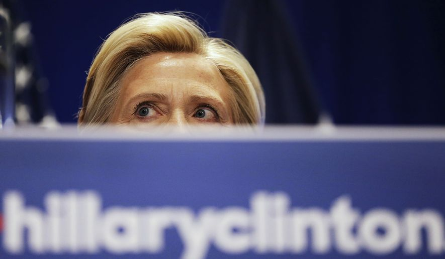 Democratic presidential candidate Hillary Rodham Clinton peers over a podium while addressing an audience during a campaign stop at Trident Technical College, Wednesday, June 17, 2015, in North Charleston, S.C. (AP Photo/David Goldman) ** FILE **