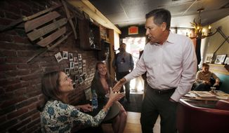 Ohio Gov. John Kasich shakes hands with customers during a walking tour of downtown Manchester, N.H., on Wednesday, June 17, 2015. Kasich is considering joining the field seeking the Republican nomination for president as he visits the nation's earliest presidential primary state. (AP Photo/Jim Cole) ** FILE **