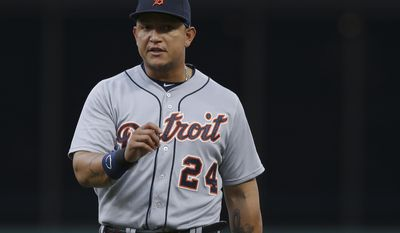 Detroit Tigers first baseman Miguel Cabrera looks toward his dugout in the second inning of a baseball game against the Cincinnati Reds, Wednesday, June 17, 2015, in Cincinnati. (AP Photo/John Minchillo)