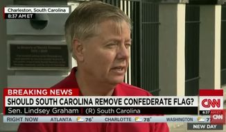 Republican presidential candidate and South Carolina Sen. Lindsey Graham on Friday defended the Confederate flag that's still flying outside of the State Capitol, despite arguments that the flag is stoking racial hatred in the community rocked by the killing of nine people by a white man at a black Charleston church. (YouTube/CNN)