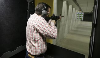 Republican presidential candidate, Sen. Ted Cruz, R-Texas, shoots a Smith & Wesson M&P15 at the CrossRoads Shooting Sports, Saturday, June 20, 2015, in Johnston, Iowa. (AP Photo/Charlie Neibergall)
