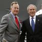 Former Presidents George H.W. Bush and George W. Bush with former Florida Gov. Jeb Bush. (Associated Press) ** FILE **