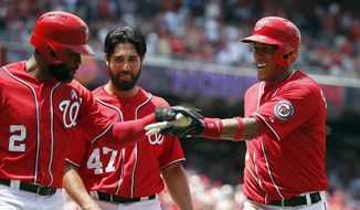 Washington Nationals' Denard Span (2), Gio Gonzalez (47) and Yunel Escobar (5) celebrate Escobar's three-run homer during the first inning of a baseball game against the Pittsburgh Pirates at Nationals Park, Sunday, June 21, 2015, in Washington. The Nationals scored nine runs in the first inning. (AP Photo/Alex Brandon)