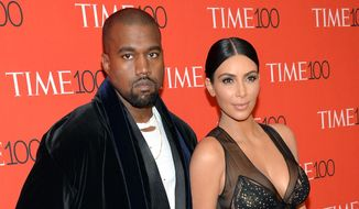In this April 21, 2015, file photo, Kanye West, left, and Kim Kardashian attend the TIME 100 Gala, in New York. Kardashian and West are expecting a baby boy, the reality TV star's representative confirmed Monday, June 22, 2015. (Photo by Evan Agostini/Invision/AP, File)