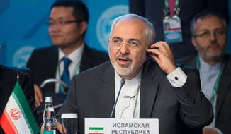 """There are still differences  but we are trying to finish the work as early as possible,"" said an optimistic Iranian Foreign Minister Mohammad Javad Zarif. (Associated Press)"