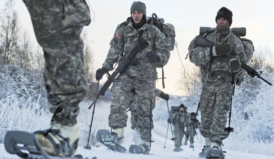 In this Dec. 6, 2012, photo provided by the U.S. Department of Defense, soldiers assigned to 6th Engineer Battalion use snow shoes during Arctic Light Individual Training on the Bulldog Trail in sub-zero conditions at Joint Base Elmendorf-Richardson, Alaska. ALIT is the United States Army Alaska's Cold Weather Indoctrination program. It gives all soldiers, regardless of their job, the foundation to successfully work, train, and go to war in some of the harshest environments in the world. (AP Photo/U.S. Air Force, Justin Connaher)