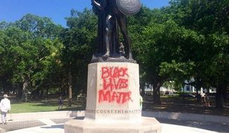 "Vandals spray-painted ""Black Lives Matter"" and other racial messages on a memorial honoring fallen Confederate soldiers in Charleston, South Carolina. (Twitter/Philip Weiss)"