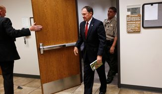 Utah Gov. Gary Herbert leaves a courtroom at the Fourth District Court, Tuesday, June 23, 2015, in Provo, Utah. A judge has dismissed Mr. Herbert from serving on a jury after the Republican governor reported to court. (Spenser Heaps/The Daily Herald via AP)