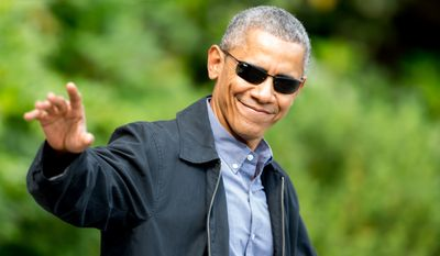 President Barack Obama waves to members of the media as he walks to Marine One on the South Lawn of the White House in Washington, Saturday, June 6, 2015, to head to Andrews Air Force Base, Md., on his way to Germany to attend the G-7 summit. (AP Photo/Andrew Harnik)