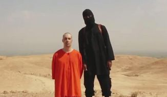 FILE - This undated file image made from a video released by Islamic State militants Tuesday, Aug. 19, 2014, purports to show the killing of journalist James Foley by the militant group. In a softening of long-standing policy, the Obama administration will tell families of Americans held by terror groups that they can communicate with the captors and even pay ransom without fear of prosecution, part of a broad review of U.S. hostage policy that will be released June 24. Four Americans have been killed by the Islamic State since last summer: journalists Foley and Steven Sotloff and aid workers Peter Kassig and Kayla Mueller. After the release of gruesome videos showing the beheadings of some hostages, Obama approved an airstrike campaign against the Islamic State in both Iraq and Syria.  (Militant website via AP, File)